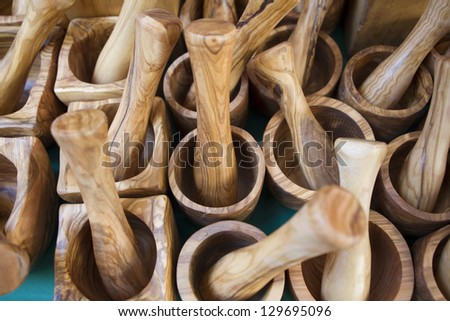 group of wooden mortars in a market stall