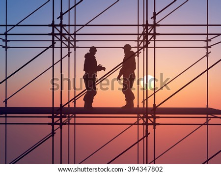 Group of workers talk among themselves. - stock photo