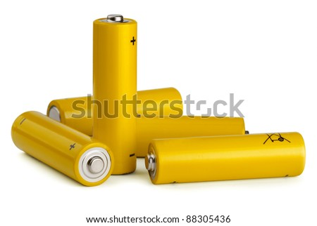 Group of yellow AA size batteries isolated on white - stock photo