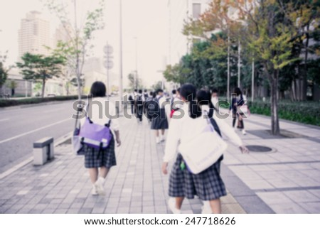 Group of yong studen walking to school - stock photo