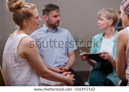 Group of young addicted people during psychotherapy - stock photo