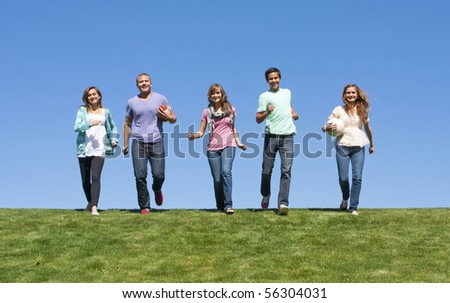 Group of Young Adults Playing Outdoors - stock photo