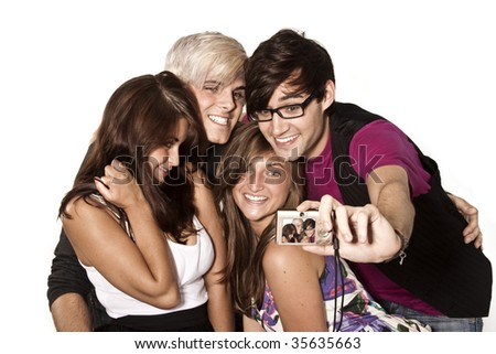 group of young adults posing for a photo with a point and shoot digital camera - stock photo