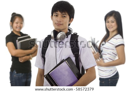 Group of young Asian students holding school books - stock photo