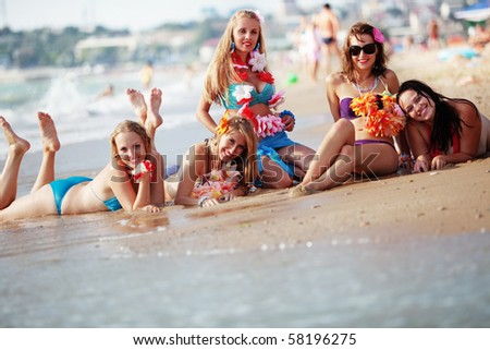 Group of young beautiful girls having fun at beach
