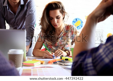 Group of young business people and designers.They working on new project.Startup concept. - stock photo