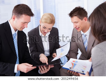 Group of young business people discussing in office