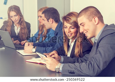 Group of young business people on a meeting - stock photo