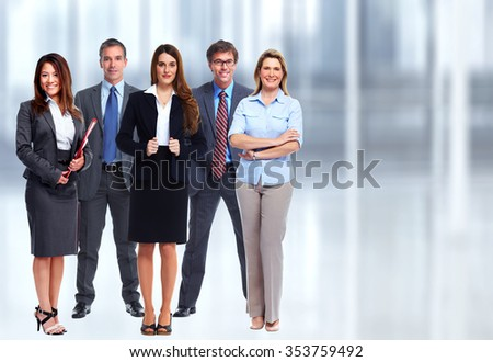 Group of young business people over blue office background.