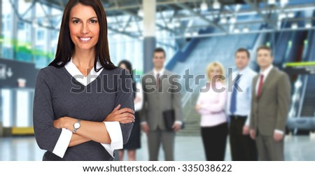 Group of young business people over modern office background. - stock photo