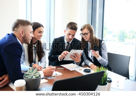 Group of young business people. They working on new project. Startup concept. - stock photo