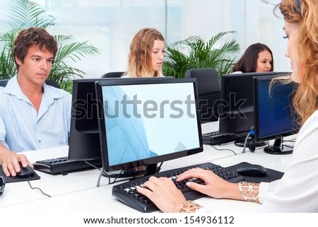 Group of young business people working together indoors.  - stock photo