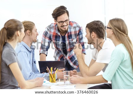 Group of young business people working with project. Young man presenting ideas for project to his business team - stock photo