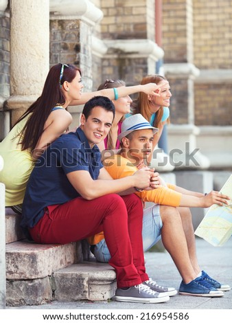 Group of young college students visiting Europe - stock photo