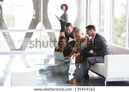 Group of young diverse ethnicity people getting together sharing ideas on the internet - stock photo