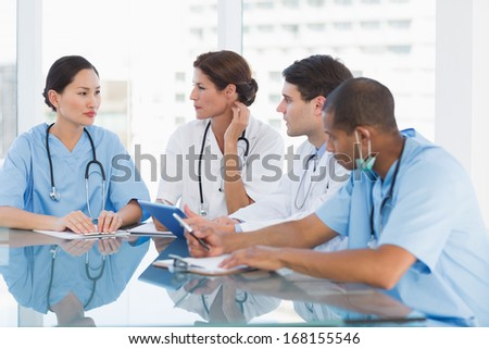 Group of young doctors in a meeting at hospital - stock photo