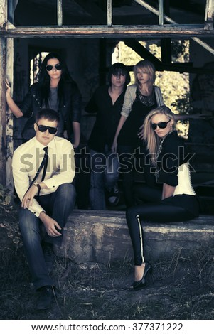 Group of young fashion men and women  - stock photo