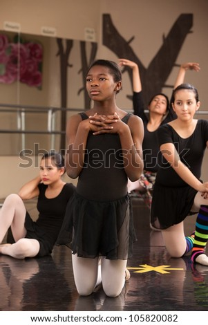 Group of young female ballet dancers waiting at rehearsal - stock photo