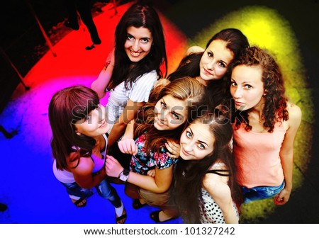 Group of young friends at a night club - stock photo