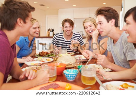 Group Of Young Friends Enjoying Meal At Home - stock photo