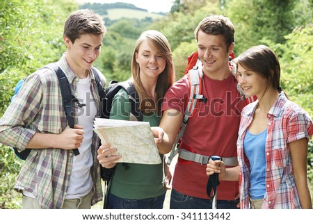 Group Of Young Friends Hiking In the Countryside - stock photo