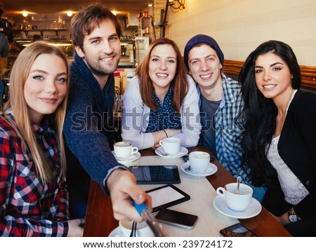 Group Of Young Friends In Cafe Taking Selfie With The Help Of Monopod
