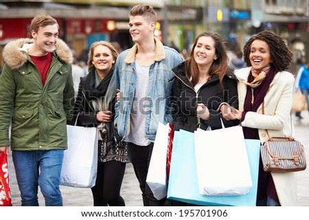 Group Of Young Friends Shopping Outdoors Together - stock photo