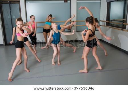Group of young girls having fun in dance studio - stock photo