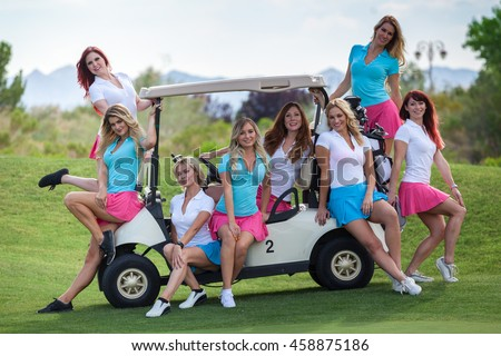 Group of young golf caddies hanging out on golf cart