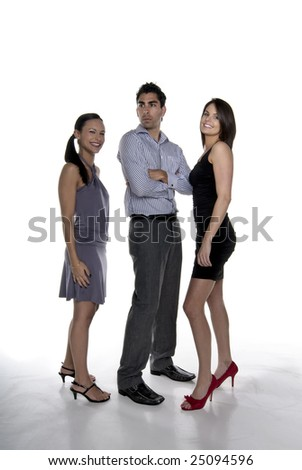 Group of 2 young happy businesswoman's with a concerned a serious man. - stock photo