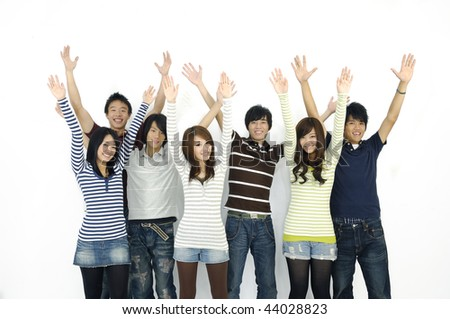 Group of young happy friends with upraised hands.