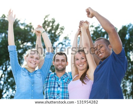 Group of young having fun outside. - stock photo