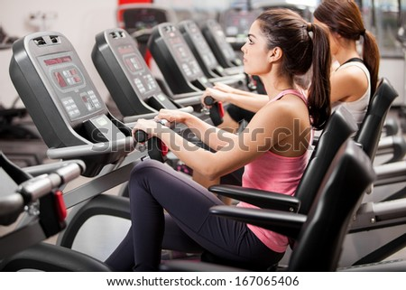 Group of young Latin women during class in a gym - stock photo