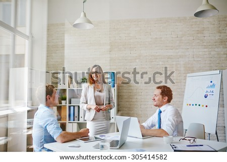 Group of young managers communicating in office