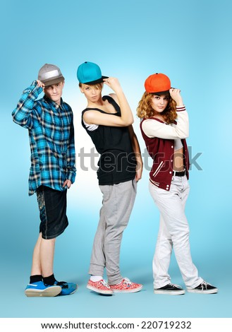 Group of young modern dancers dancing together with fun. Studio shot. - stock photo