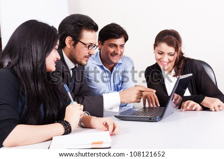 group of young multi racial business people in meeting - stock photo