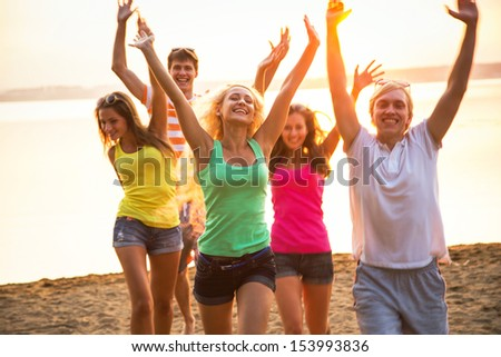 Group of young people at the beach of sea - stock photo