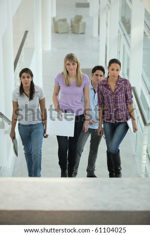Group of young people climbing stairs - stock photo