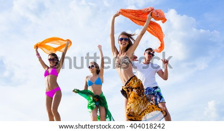 group of young people enjoying a beach party - stock photo