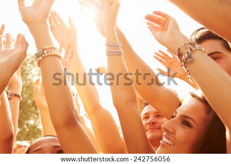 Group Of Young People Enjoying Outdoor Music Festival - stock photo