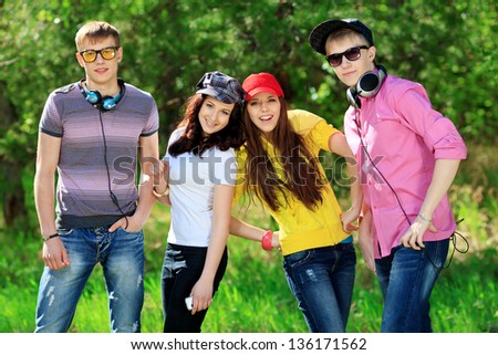 Group of young people having a rest together outdoors. - stock photo