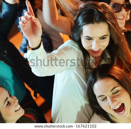 Group of young people having fun dancing at party - stock photo