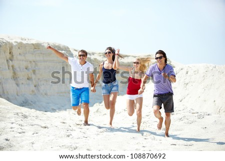 Group of young people having fun on beach - stock photo