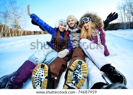 Group of young people having winter rest outdoor.