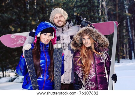 Group of young people having winter rest outdoor. - stock photo