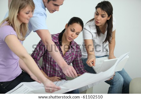 Group of young people in architect training - stock photo