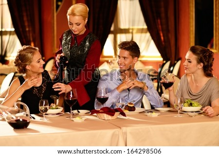 Group of young people in luxury restaurant interior  - stock photo