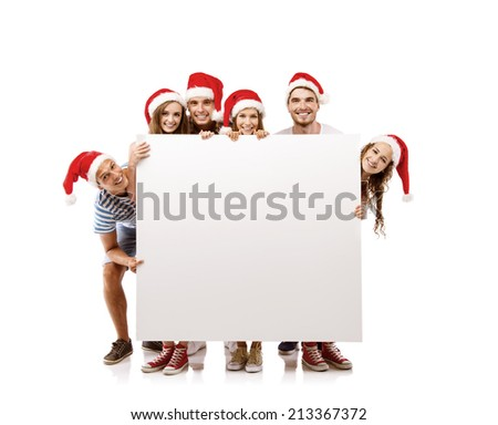 Group of young people in santa hats with copy space, isolated on white background - stock photo