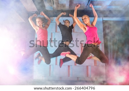 Group of young people jumping during music - stock photo