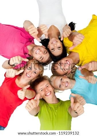 group of young people lying down on floor in circle  holding thumb up gesture, teenage students happy smile top angle view isolated over white background